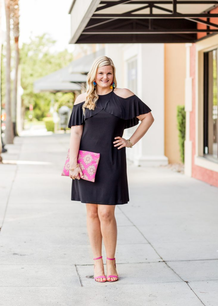 Black Dress and Pink Shoes Outfit featured by top Orlando fashion blog, Fabulously Overdressed: image of a woman wearing a Ross off the shoulder black dress and pink shoes.