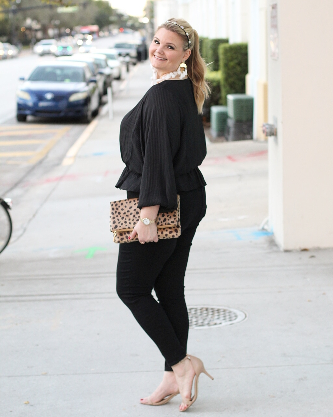 1.State outfits featured by top Orlando fashion blog, Fabulously Overdressed: image of a woman wearing a 1.State Shadow stripe 1.state top with black jeans