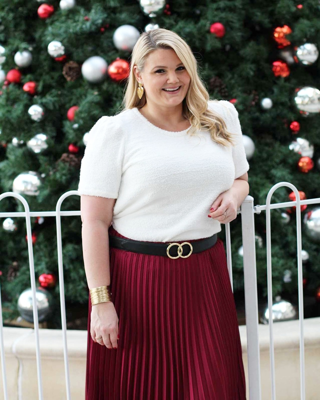 1.State outfits featured by top Orlando fashion blog, Fabulously Overdressed: image of a woman wearing a 1.State red pleated skirt