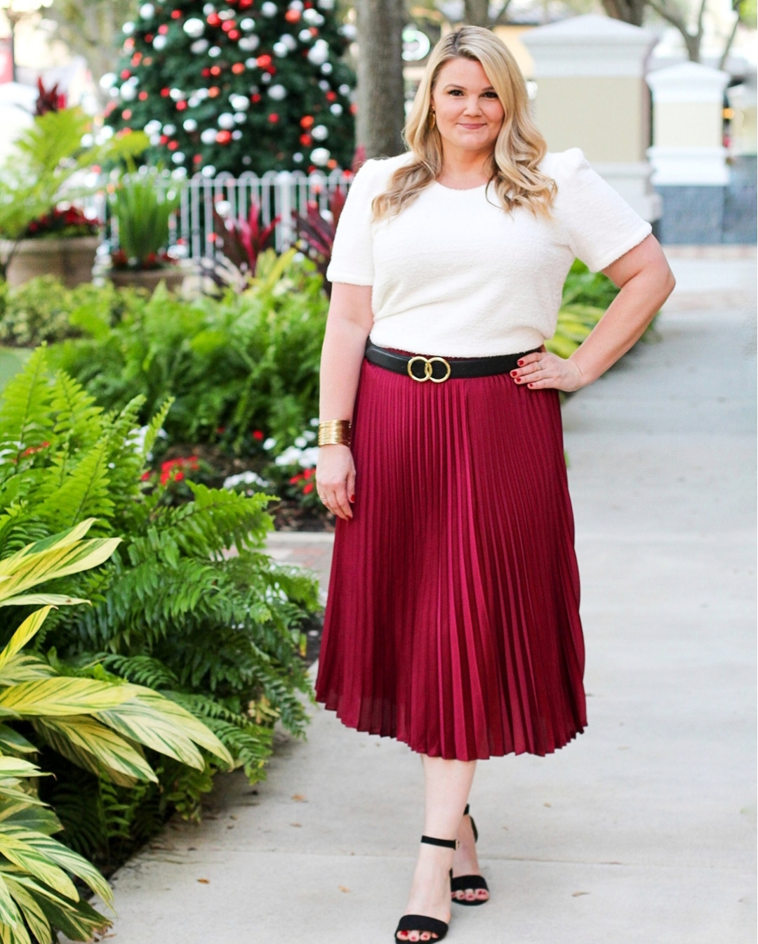 1.State outfits featured by top Orlando fashion blog, Fabulously Overdressed: image of a woman wearing a 1.State Eyelash sweater with pleated skirt