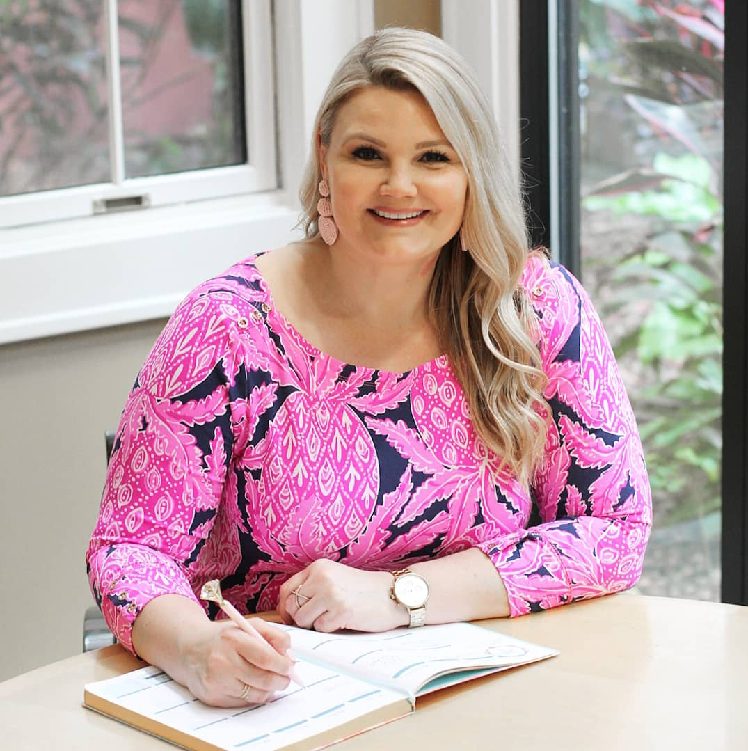 How to Make Life Easier: 12 Top Tips featured by top US lifestyle blog, Fabulously Overdressed: image of a woman writing in an Erin Condren planner.