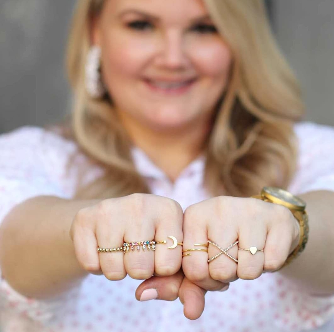 Top 3 jewelry trends featured by Orlando fashion blog, Fabulously Overdressed: image of a woman wearing delicate rings.