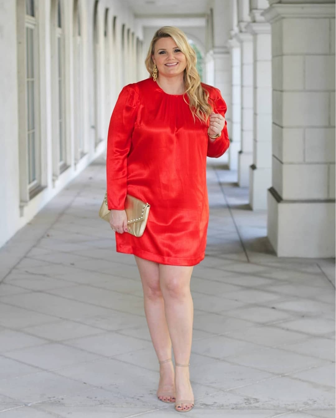 Valentine's Day outfit inspiration featured by Orlando fashion blog, Fabulously Overdressed: image of a woman wearing red dress